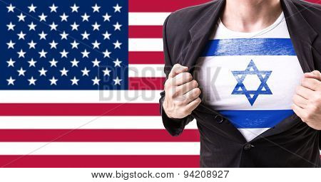 Businessman stretching suit with Israel flag on american flag background