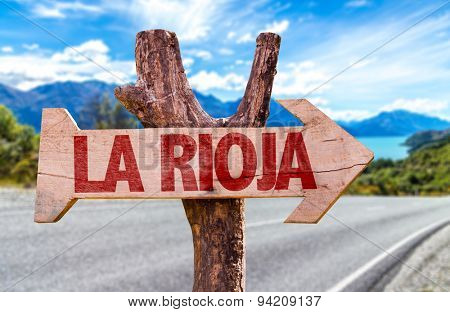 Rioja wooden sign with road background