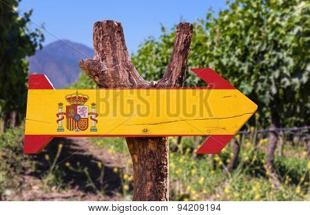 Spain Flag wooden sign with vineyard background