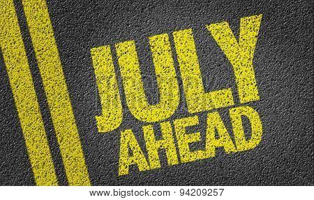 July Ahead written on the road