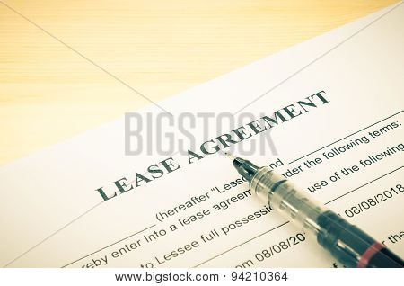 Lease Agreement Contract Document And Pen At Bottom Right Corner Vintage Style