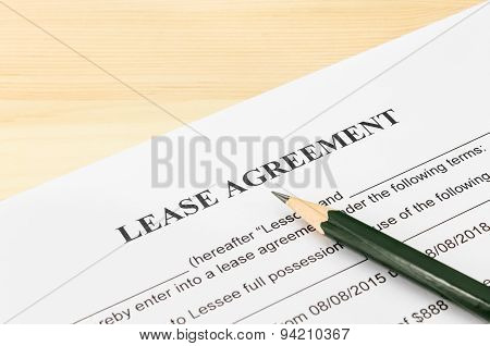 Lease Agreement Contract Document And Pencil At Bottom Right Corner