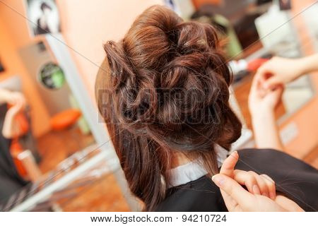 creating hairstyles hairdresser at salon. indoor shot