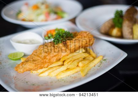 Fish And Chips Served With Tartar Sauce