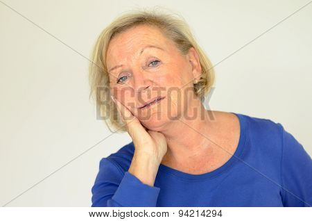 Worried Elderly Lady Looking At The Camera