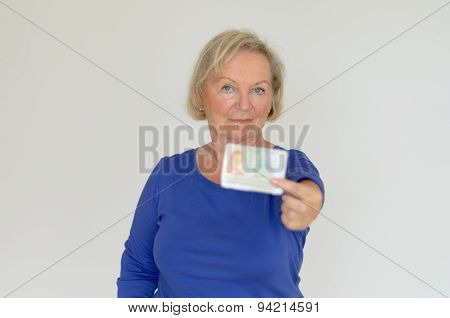Senior Lady Holding Out Her Business Card