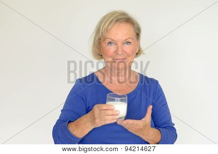 Healthy Senior Lady Drinking Fresh Milk