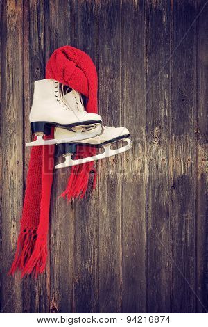 Old Ice Skates Hanging On Rustic Wooden Wall