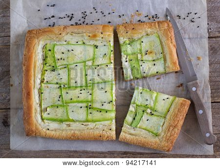 Tart  of puff pastry with  zucchini and goat cheese. Selective Focus