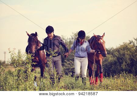 Happy Couple With Two Horses
