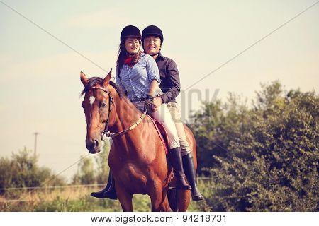 Couple Riding A Horse