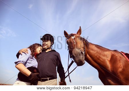 Couple Playing With A Horse