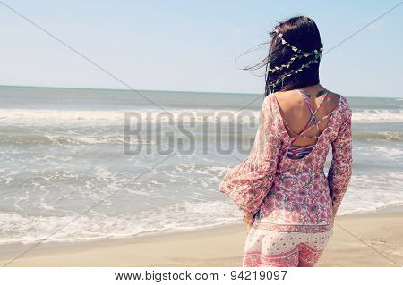 beautiful woman facing the sea