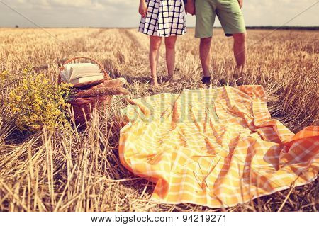 Legs Of Man And Woman In The Fields