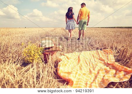 Couple Holding Hands In The Fields