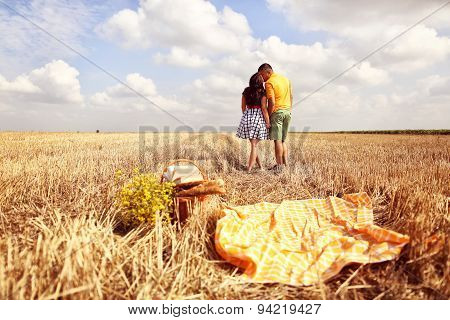 Couple Kissing In The Fields