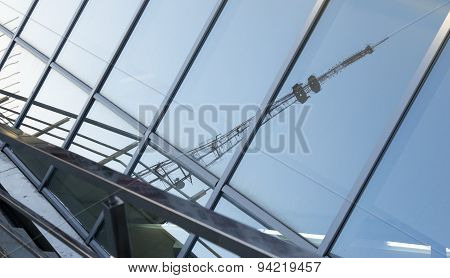 Television Mast Reflected On Glass Window