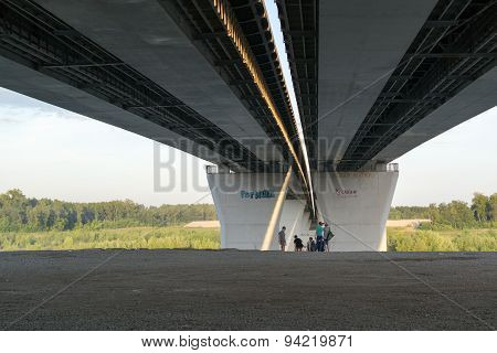 Group Of Children Playing Under A Bridge