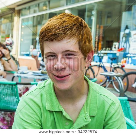 Boy With Red Hair Is Looking Happy And Friendly
