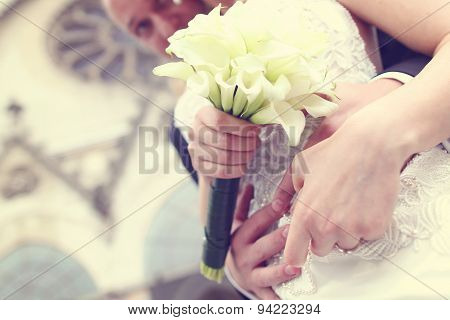 Hands With Lilly Bouquet