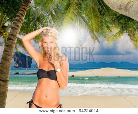 Woman on a tropical beach sunbathing