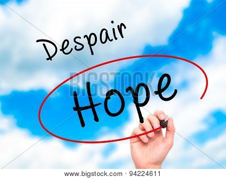 Man Hand writing and choosing Hope instead of Despair with black marker on visual screen