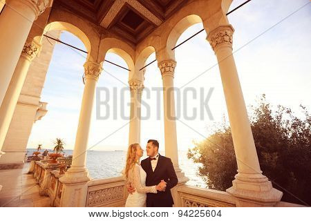 Bride And Groom In The Sunlight At Castle