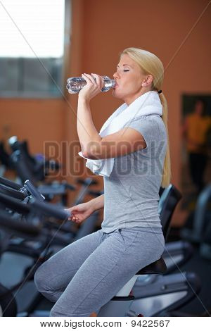 Woman Drinking Water On Hometrainer