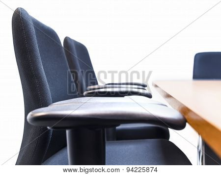 Seats with table in meeting room White Background