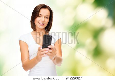 people, summer, technology and internet concept - young woman taking selfie with smartphone over green natural background