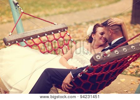 Bride And Groom In A Swing