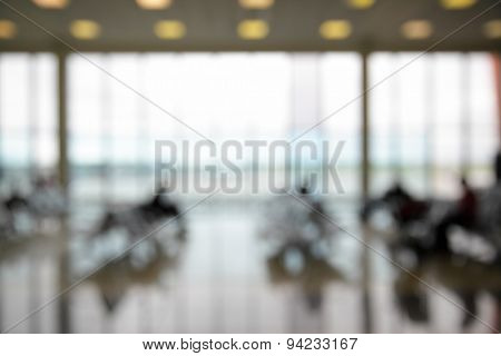 Passengers in the airport lounge out of focus