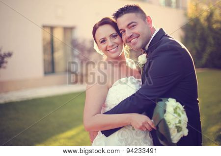 Beautiful Bridal Couple In The Sunlight