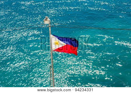 Flag Of Philippines Over Aqua Water