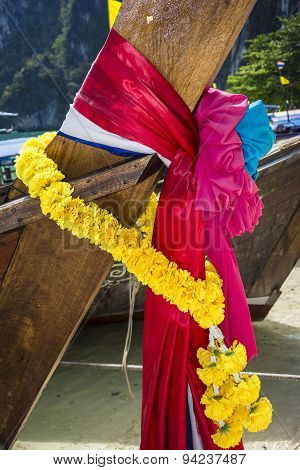 Coloured ribbons in a Thai longtail boat
