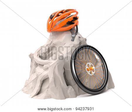 Helmet and wheel in mountains