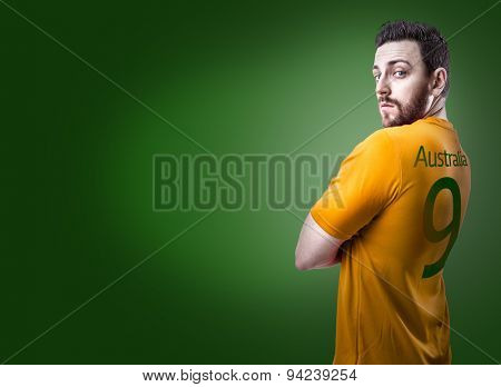 Aussie soccer player on green background