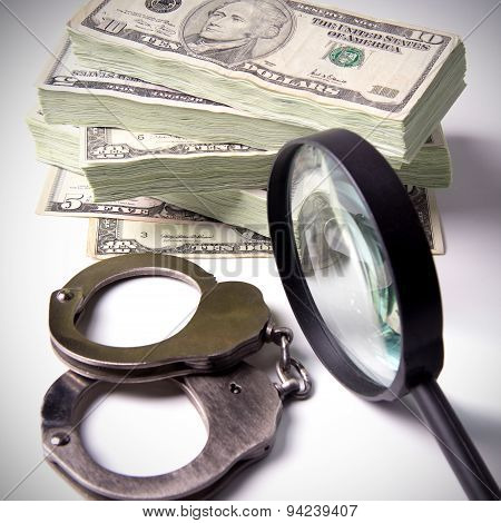 Dollars, Magnifying Glass And Handcuffs