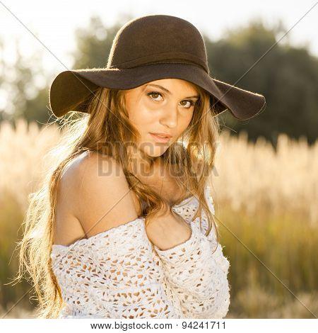 Model In Open Field At Sunrise