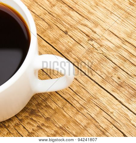 Cup Of Black Coffee On Old Wooden Table - View From Top