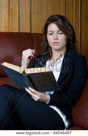 The Girl In A Suit Reads The Book