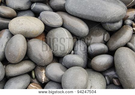 Wet beach pebbles background