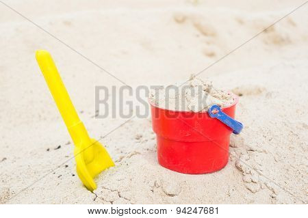 Red Bucket And Yellow Spade