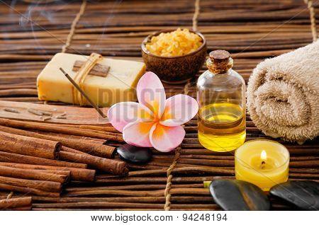 Spa setting on mat with frangipani