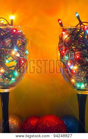 Glasses With A Yellow Background Garlands With Christmas Toys