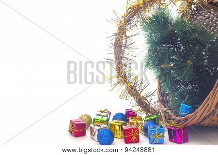 Inverted Basket Of Christmas Toys And Christmas Tree
