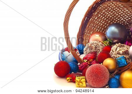 Inverted Basket With Christmas Toys On A White Background