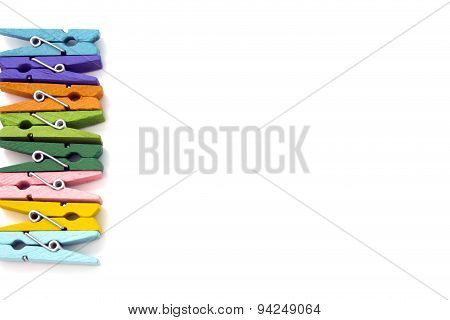 Background Of Multi Colored Linen Clothespins Isolated On White