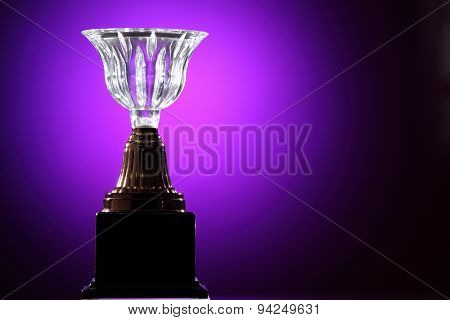 crystal trophy on the purple background
