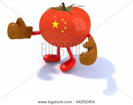 Tomato With Boxing Gloves And Chinese Flag On The Peel
